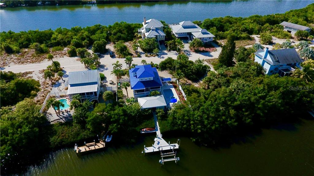 Rear Aerial View of Home with Dock on Kettle Harbor. - Single Family Home for sale at 120 Bocilla Dr, Placida, FL 33946 - MLS Number is D5907510