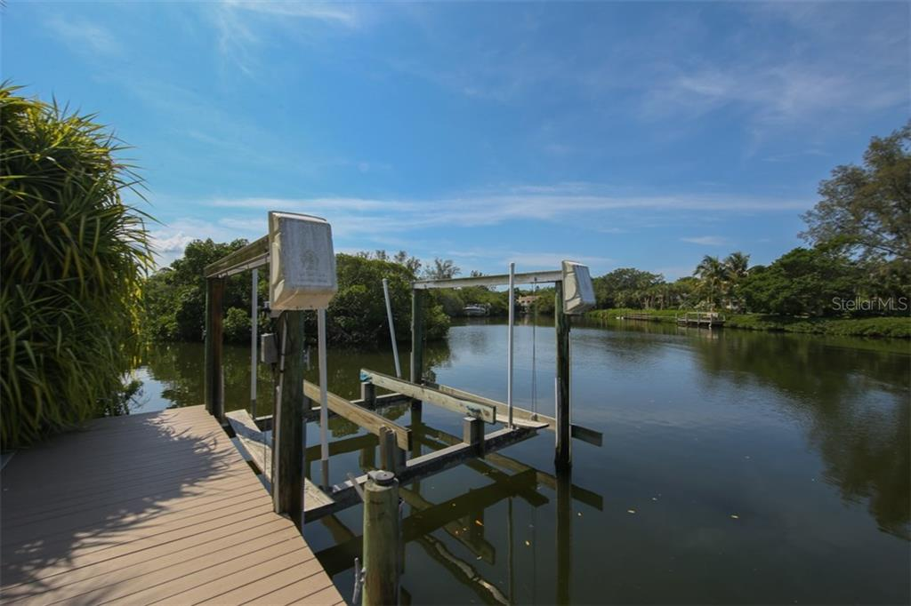 Dock & Lift - Single Family Home for sale at 7295 Manasota Key Rd, Englewood, FL 34223 - MLS Number is D5911936