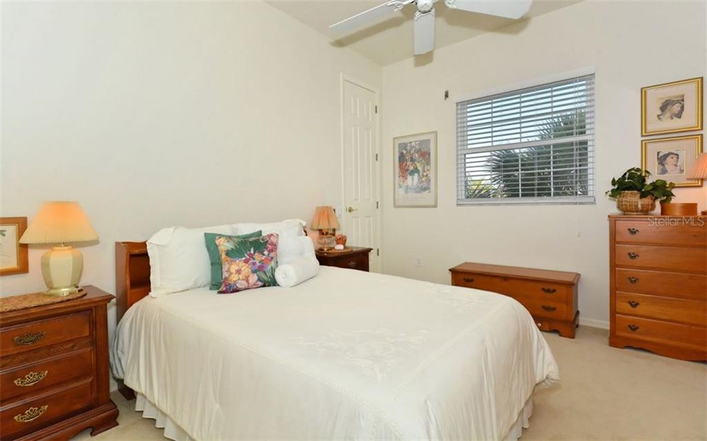 Guest house master bed - Single Family Home for sale at 730 N Manasota Key Rd, Englewood, FL 34223 - MLS Number is D5912725