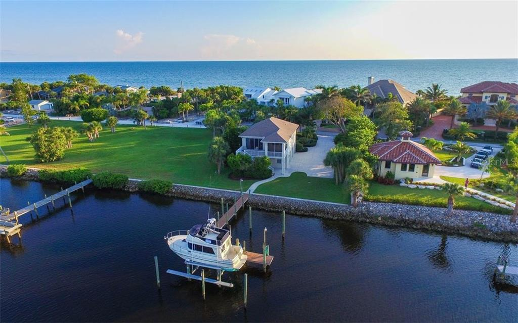 Guest house with dock and 20K lb boat lift - Single Family Home for sale at 730 N Manasota Key Rd, Englewood, FL 34223 - MLS Number is D5912725