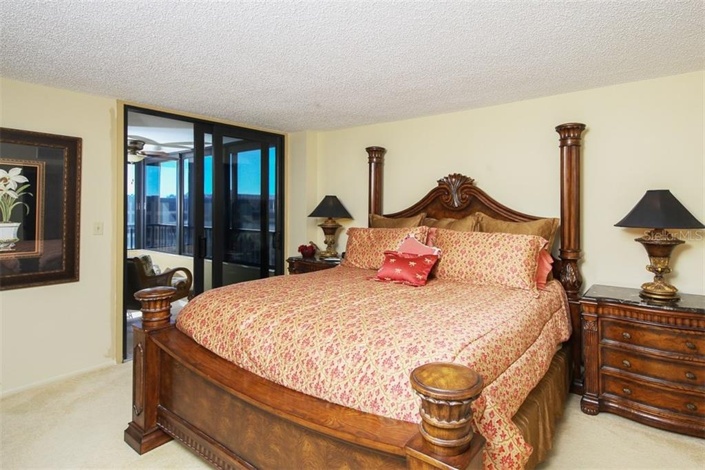 Master Bedroom with Doors to Screened Lanai with Windows - Condo for sale at 5760 Midnight Pass Rd #702, Sarasota, FL 34242 - MLS Number is D5916943