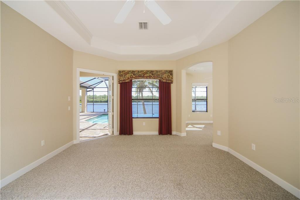 Master Bedroom with en Suite Bath & Sitting Room/Office, French Doors to Lanai - Single Family Home for sale at 550 Coral Creek Dr, Placida, FL 33946 - MLS Number is D5917129