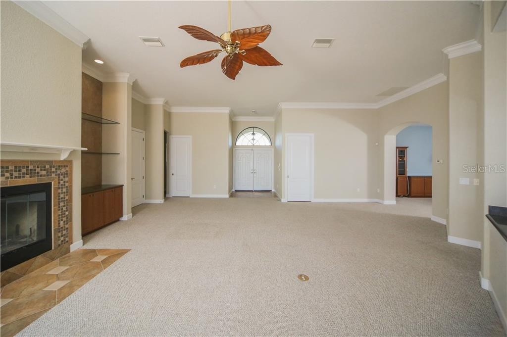 Great Room with Wood Burning Fireplace - Single Family Home for sale at 550 Coral Creek Dr, Placida, FL 33946 - MLS Number is D5917129
