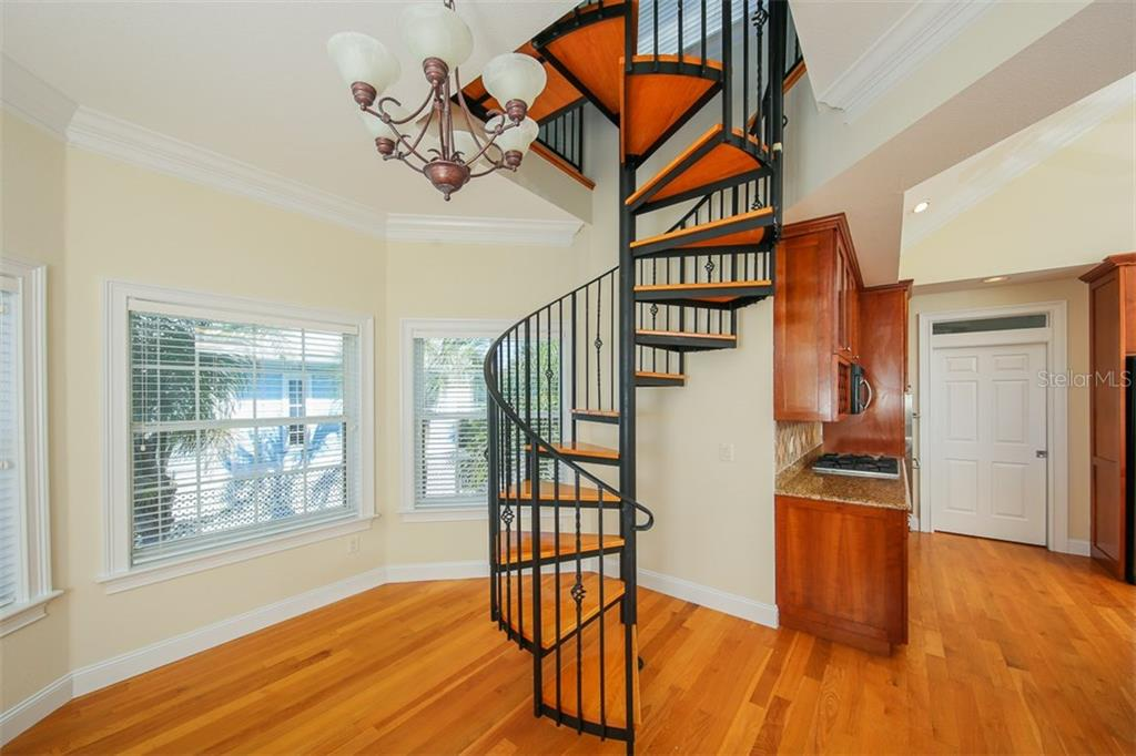 Spiral Staircase to Office - Single Family Home for sale at 7020 Palm Island Dr, Placida, FL 33946 - MLS Number is D5917629