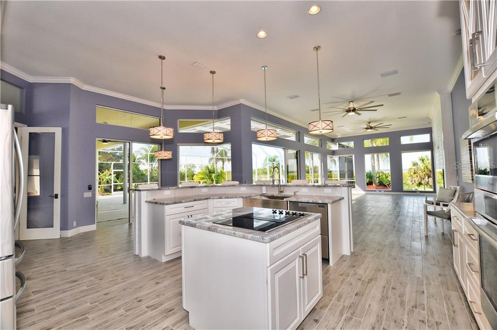 The home features 4 bedrooms and all have their own private bath. There are pocket slider with each bedroom to give privacy. - Single Family Home for sale at 3121 Rivershore Ln, Port Charlotte, FL 33953 - MLS Number is D5917816