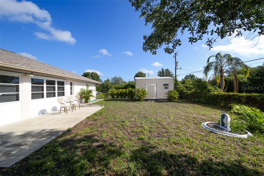 Shed - Single Family Home for sale at 7044 Quigley St, Englewood, FL 34224 - MLS Number is D5918526