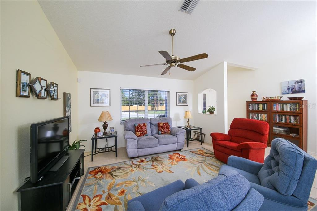 Living Room - Single Family Home for sale at 7044 Quigley St, Englewood, FL 34224 - MLS Number is D5918526