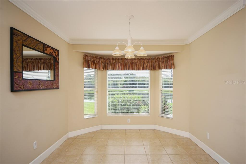 Dining room off of the kitchen - Single Family Home for sale at 414 Tomoka Dr, Englewood, FL 34223 - MLS Number is D5919831