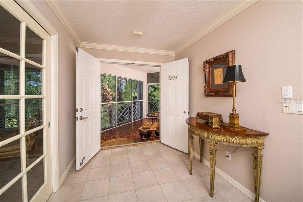 Foyer entry - Condo for sale at 11000 Placida Rd #2804, Placida, FL 33946 - MLS Number is D5920736