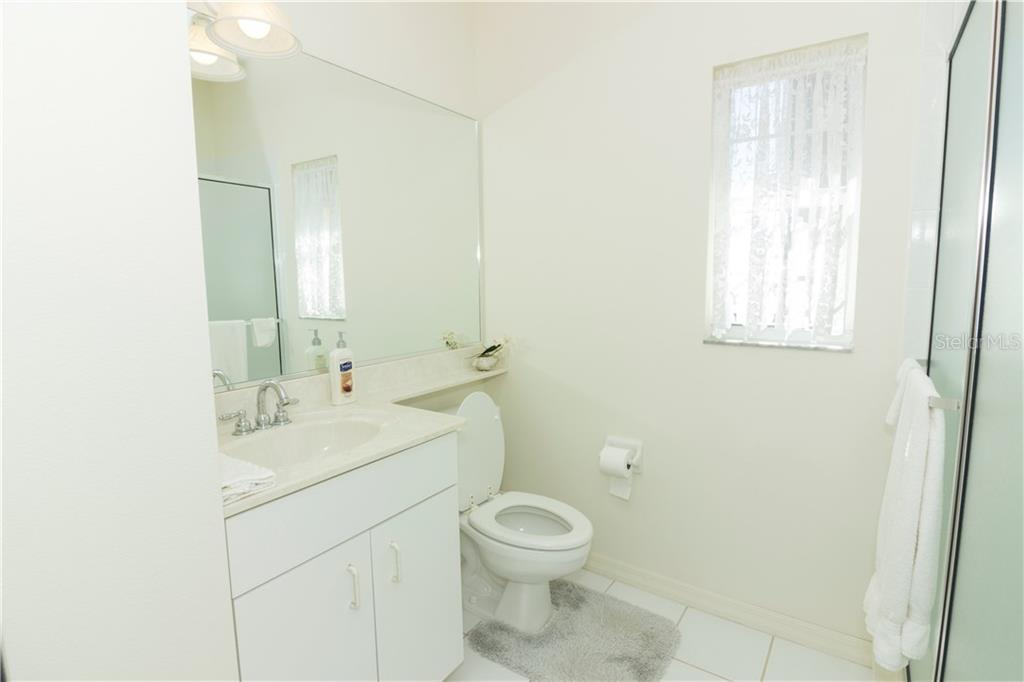... with ensuite bath. - Single Family Home for sale at 1439 Deer Creek Dr, Englewood, FL 34223 - MLS Number is D5921060