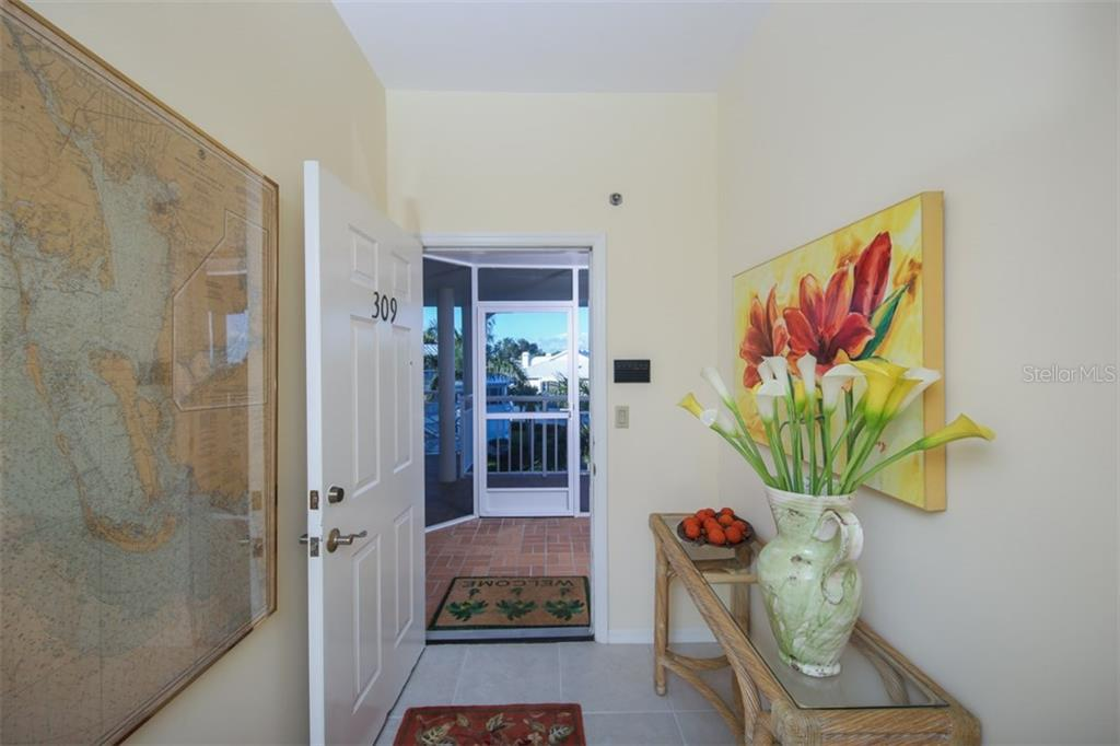 Front screened lanai & Foyer entry - Condo for sale at 11000 Placida Rd #309, Placida, FL 33946 - MLS Number is D5921681