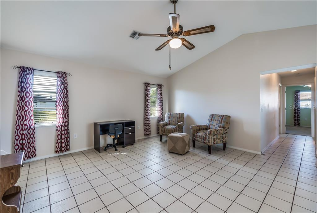 Family room - Single Family Home for sale at 11010 Deerwood Ave, Englewood, FL 34224 - MLS Number is D5921766