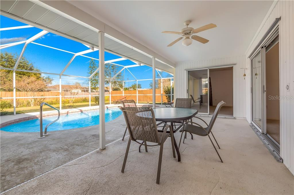Lanai with screened pool area. - Single Family Home for sale at 11010 Deerwood Ave, Englewood, FL 34224 - MLS Number is D5921766