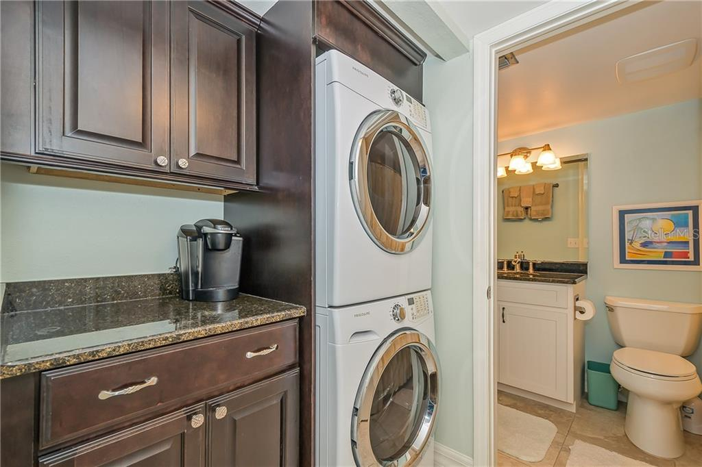 LAUNDRY AREA AND GUEST BATHROOM - Condo for sale at 5700 Gulf Shores Dr #a-317, Boca Grande, FL 33921 - MLS Number is D5922412