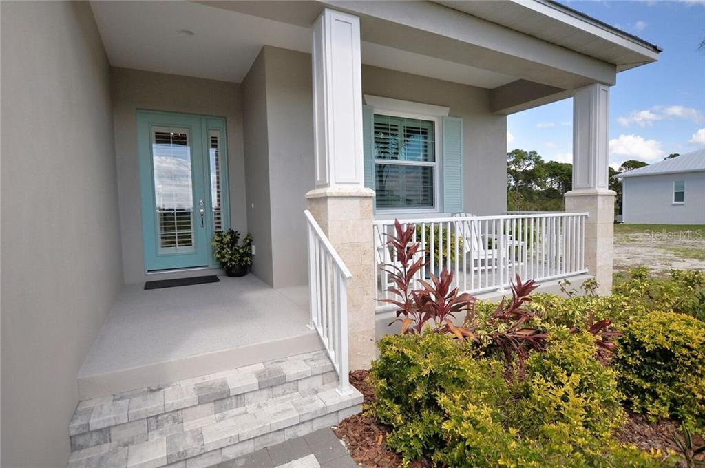 Front Porch - Single Family Home for sale at 8944 Scallop Way, Placida, FL 33946 - MLS Number is D5923173