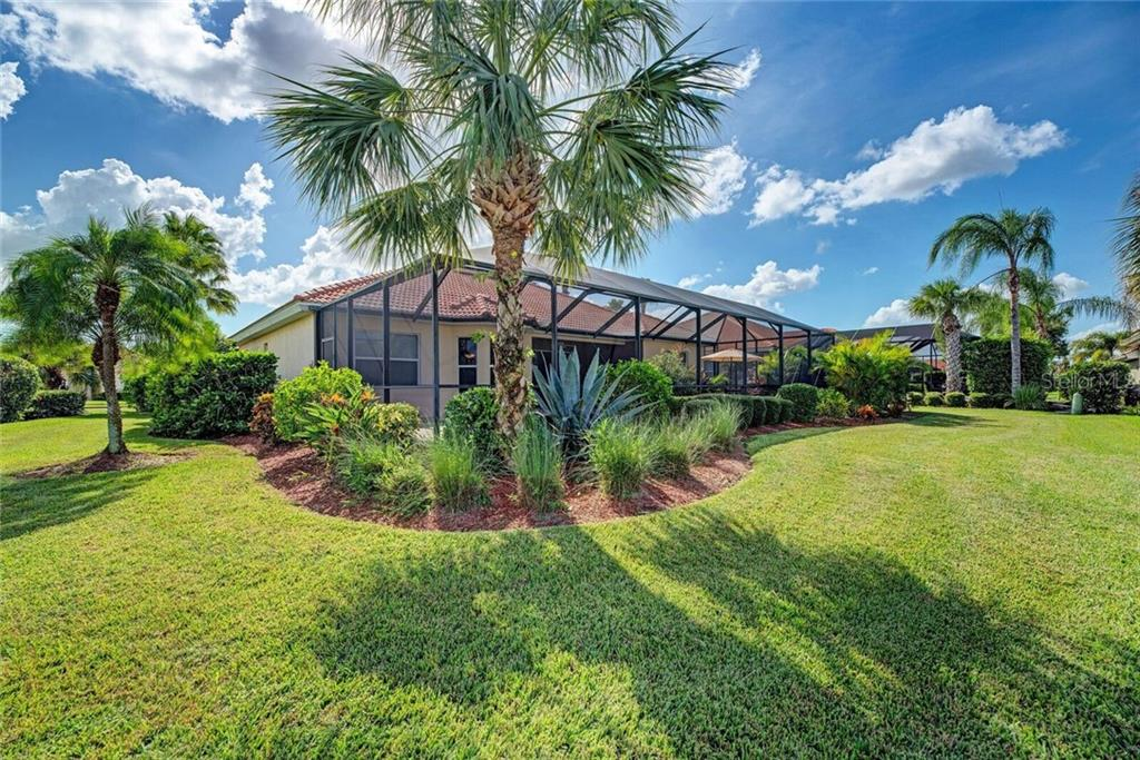 Beautifully landscaped grounds - Single Family Home for sale at 409 Montelluna Drive, North Venice, FL 34275 - MLS Number is D5923522