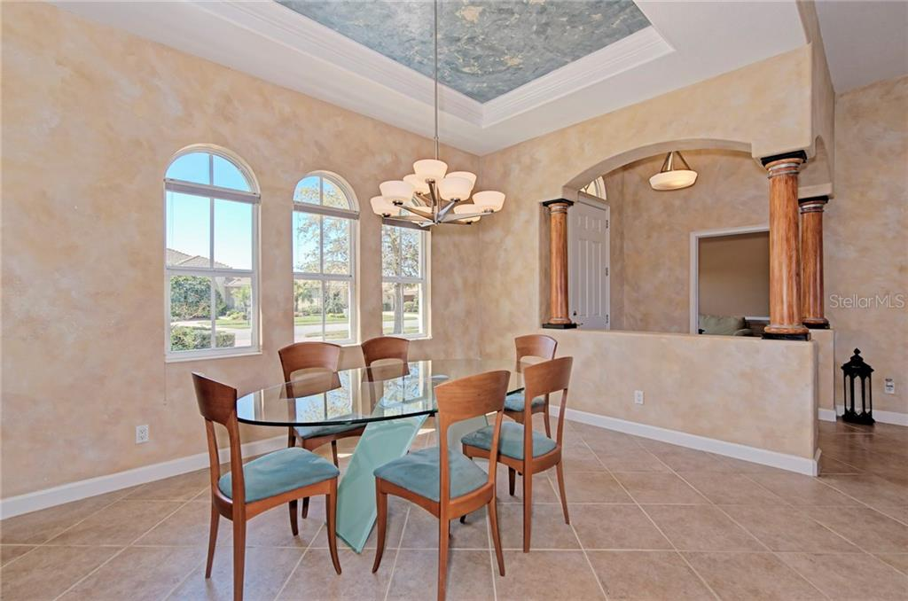 Dining room - Single Family Home for sale at 409 Montelluna Drive, North Venice, FL 34275 - MLS Number is D5923522