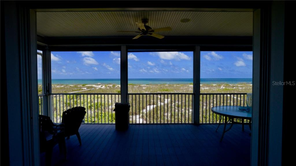 One of two upstairs bedrooms.  Each bedroom upstairs has it's own doors exiting out onto another deck with views of the Gulf. - Single Family Home for sale at 9722 Little Gasparilla Is, Placida, FL 33946 - MLS Number is D6100685