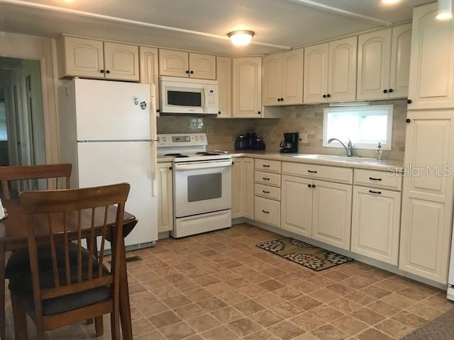 New kitchen with room for a cozy table for two.  Lots of cabinet and counter space and includes a portable dishwasher. - Single Family Home for sale at 1372 Ibis Dr, Englewood, FL 34224 - MLS Number is D6100727