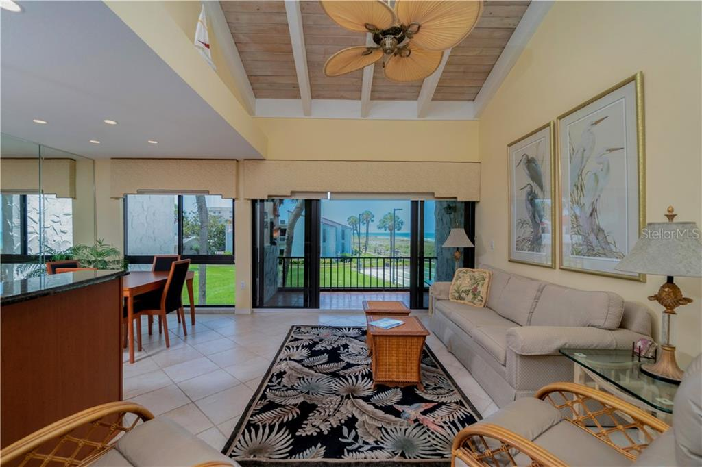 Living room with a view. - Condo for sale at 500 Park Blvd S #57, Venice, FL 34285 - MLS Number is D6100773
