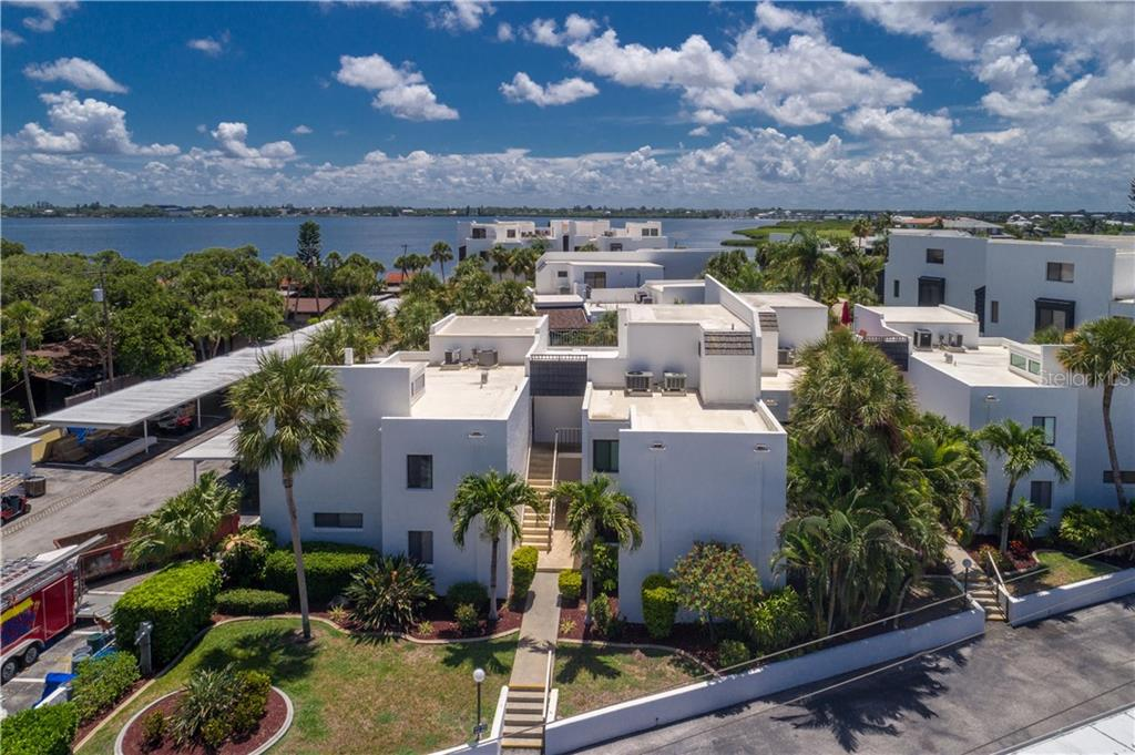 Aerial view of the B6 building with Lemon Bay in the background - Condo for sale at 2955 N Beach Rd #b612, Englewood, FL 34223 - MLS Number is D6101147