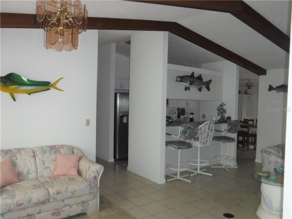 Vaulted ceilings in large great room. - Single Family Home for sale at 3001 Pellam Blvd, Port Charlotte, FL 33948 - MLS Number is D6101282