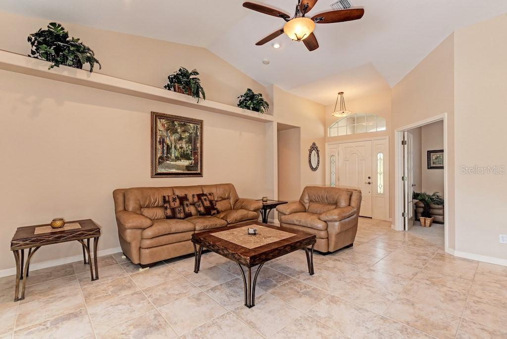 Front door, living area, and den with french doors. - Single Family Home for sale at 7256 Holsum St, Englewood, FL 34224 - MLS Number is D6101787