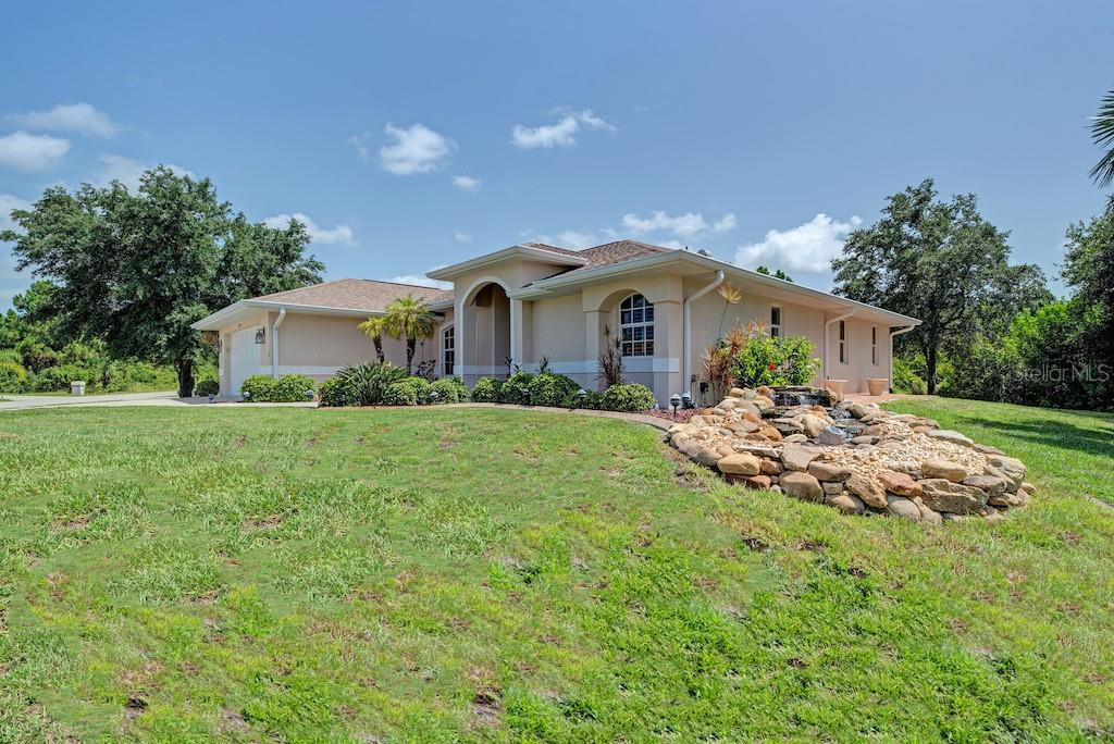Beautiful stone custom waterfall adds character to this property. - Single Family Home for sale at 7256 Holsum St, Englewood, FL 34224 - MLS Number is D6101787