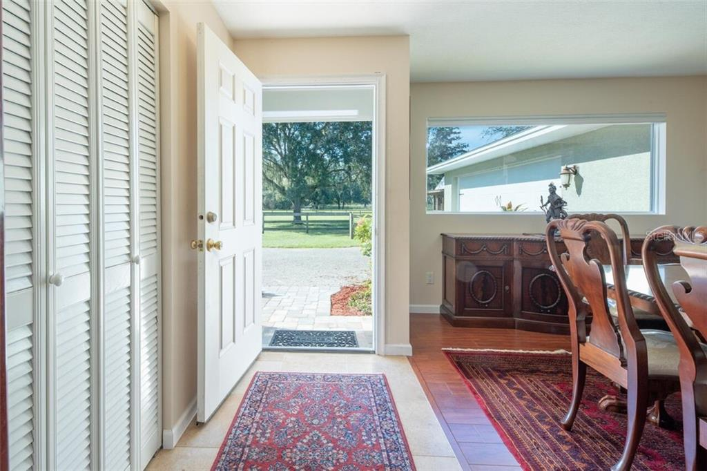 A sensible foyer provides entry to your private retreat.  Close to world famous beaches, it's like living in the country but minutes from everything. - Single Family Home for sale at 7339 Hawkins Rd, Sarasota, FL 34241 - MLS Number is D6102762