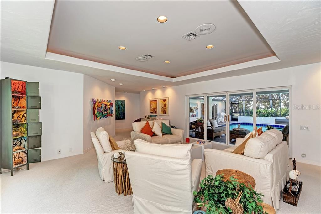 The large great room offers many choices for seating arrangements. - Single Family Home for sale at 7400 Manasota Key Rd, Englewood, FL 34223 - MLS Number is D6104362