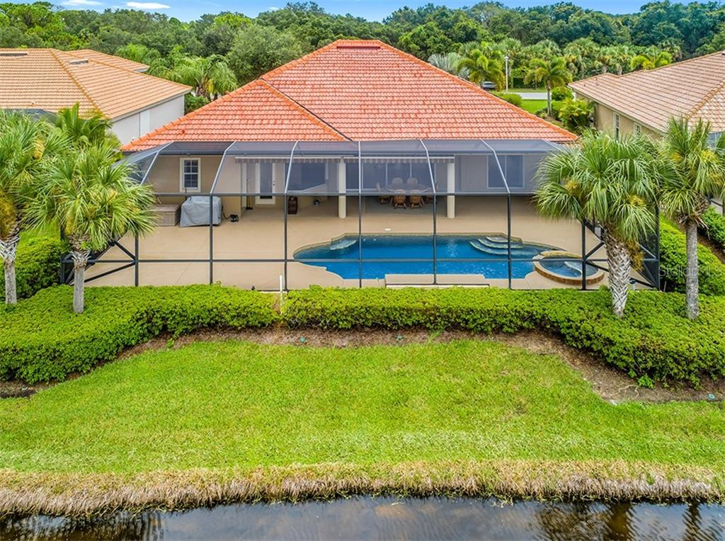 Large covered Lanai, with 2 retractable awnings - GREAT VIEW & SUNSETS - Single Family Home for sale at 2684 Sable Palm Way, Port Charlotte, FL 33953 - MLS Number is D6104434