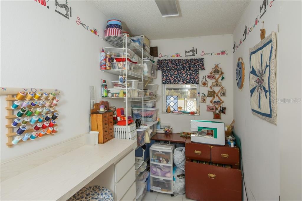 This is the inside utility room which was made into a craft area by the Owner. - Single Family Home for sale at 9387 Westminster Ave, Englewood, FL 34224 - MLS Number is D6104451