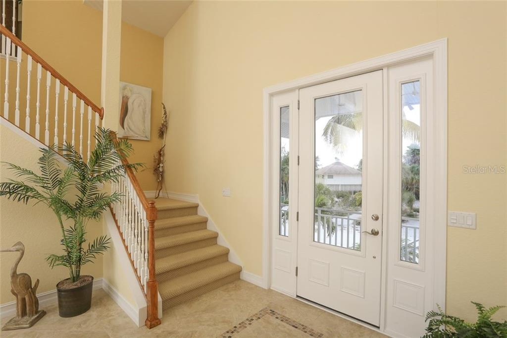 Front Entrance - Single Family Home for sale at 290 Kettle Harbor Dr, Placida, FL 33946 - MLS Number is D6104705