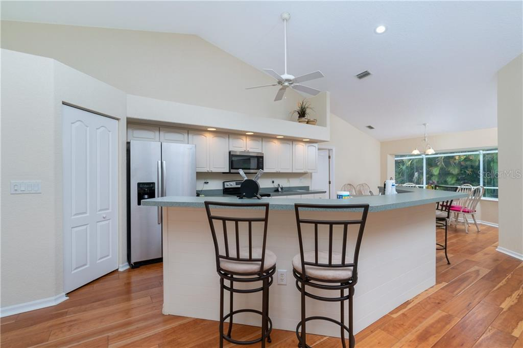 Kitchen has plant shelf, ceiling fan and recessed lighting. - Single Family Home for sale at 30 Medalist Way, Rotonda West, FL 33947 - MLS Number is D6106239