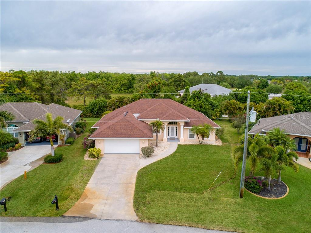 An aerial view of the property and surrounding neighborhood. - Single Family Home for sale at 30 Medalist Way, Rotonda West, FL 33947 - MLS Number is D6106239
