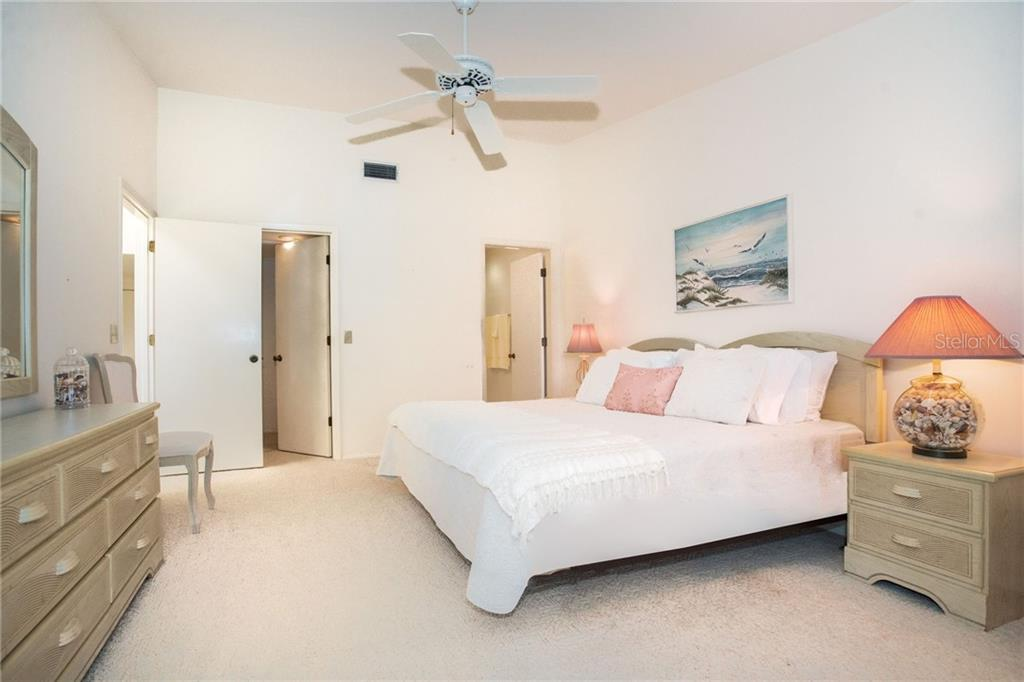 Larger master bedroom with walk-in closet, private bathroom and access via sliding doors to the large lanai. - Condo for sale at 6800 Placida Rd #271, Englewood, FL 34224 - MLS Number is D6106459