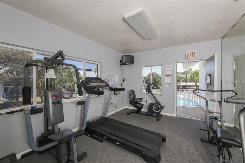 Fitness center at the Fiddler's Green clubhouse. - Condo for sale at 6800 Placida Rd #271, Englewood, FL 34224 - MLS Number is D6106459