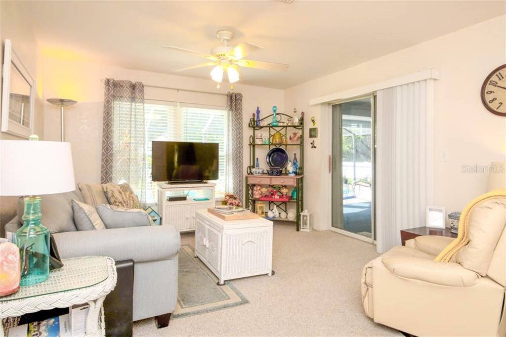 family room with sliders to pool & view - Single Family Home for sale at 913 Tropical Ave Nw, Port Charlotte, FL 33948 - MLS Number is D6108061