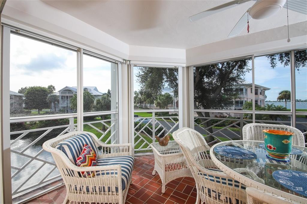 Relax on your lanai while taking in the lake & Intracoastal views - Condo for sale at 11000 Placida Rd #2301, Placida, FL 33946 - MLS Number is D6108434