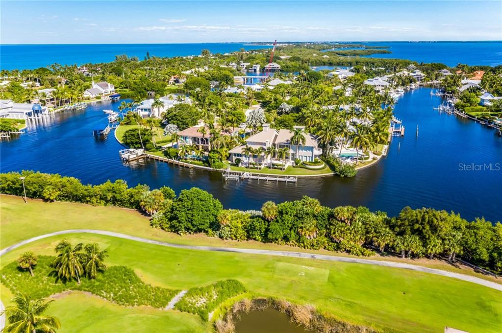 Aerial of golf course and surrounding area - Single Family Home for sale at 1600 Gaspar Dr S, Boca Grande, FL 33921 - MLS Number is D6109050