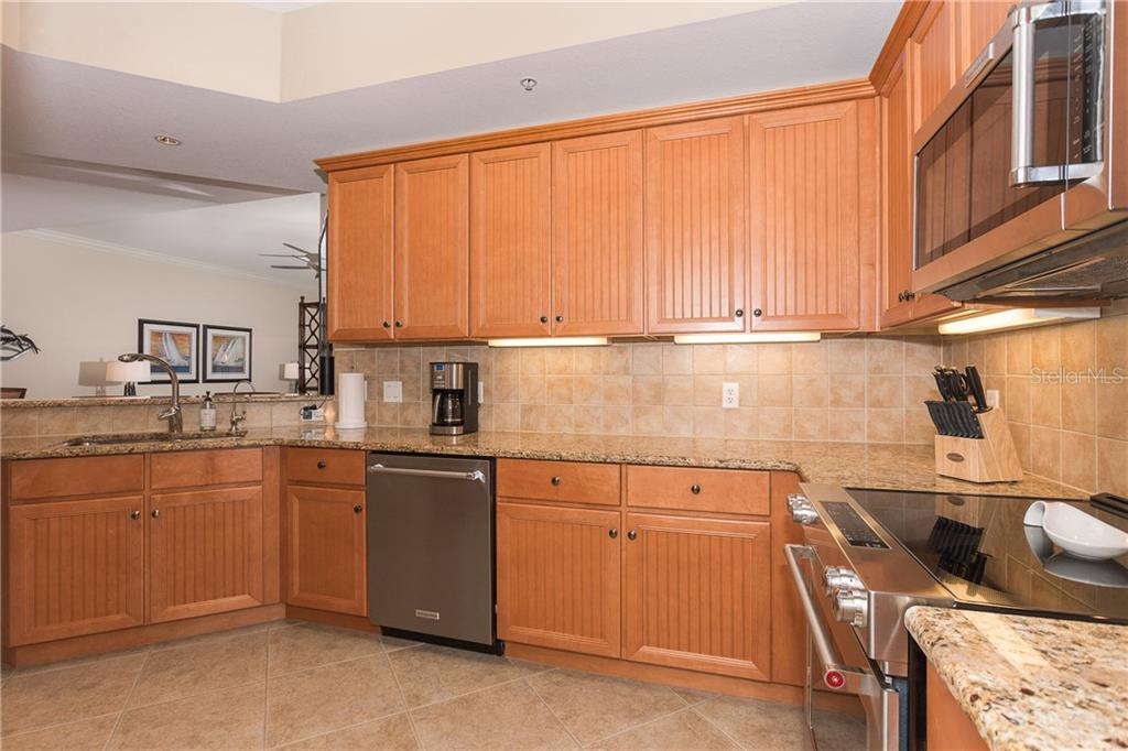 Great storage and spacious kitchen for all your entertaining including an upgraded convection oven - Condo for sale at 8561 Amberjack Cir #202, Englewood, FL 34224 - MLS Number is D6109771