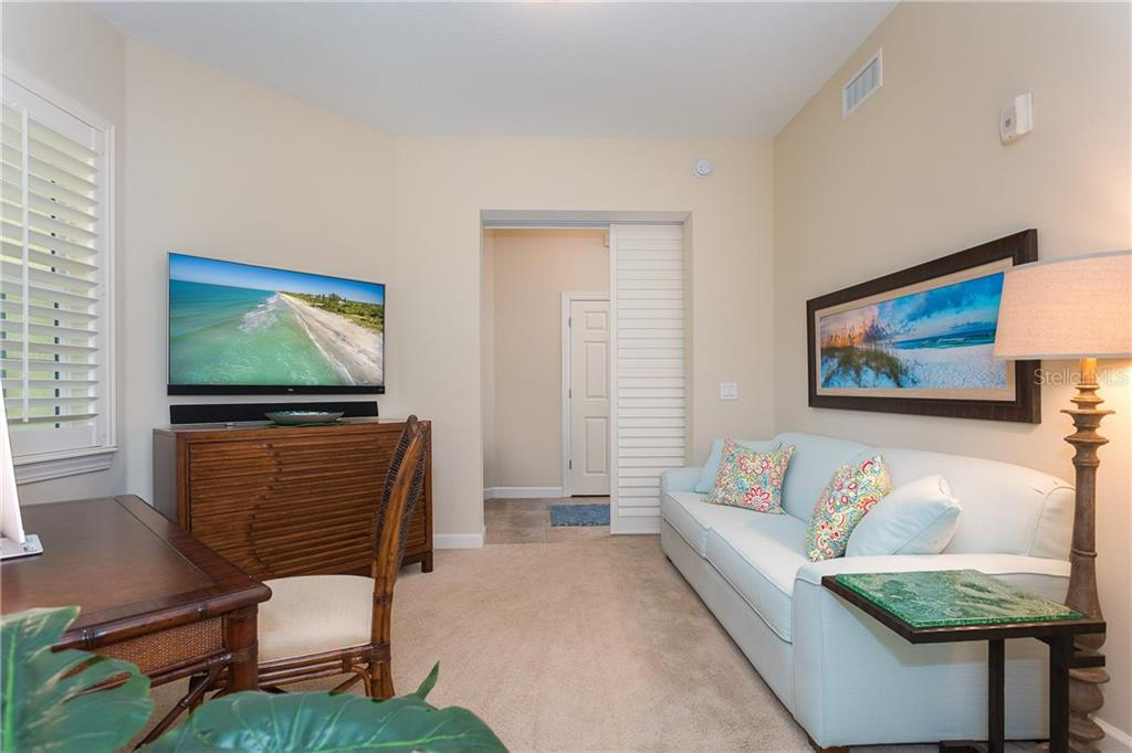 3rd Bedroom or Office with Sliding Plantation Doors - Condo for sale at 8561 Amberjack Cir #202, Englewood, FL 34224 - MLS Number is D6109771