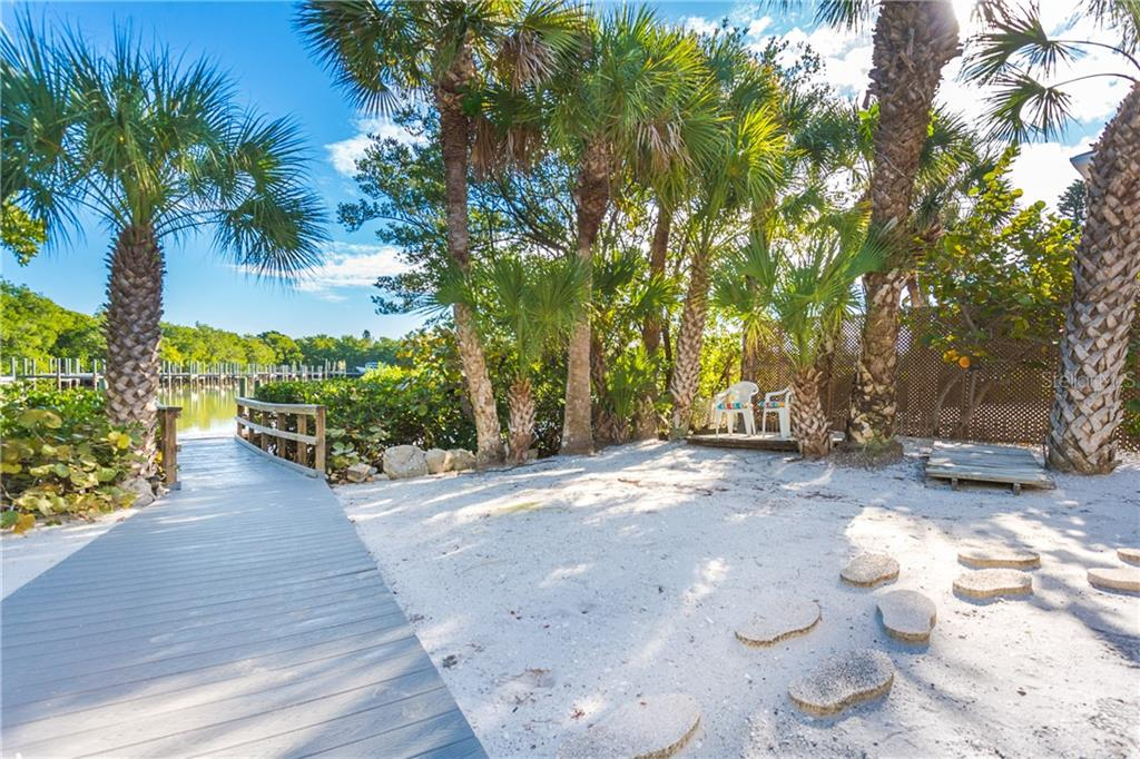 Rear of Property and Dock. - Single Family Home for sale at 540 N Gulf Blvd, Placida, FL 33946 - MLS Number is D6110801