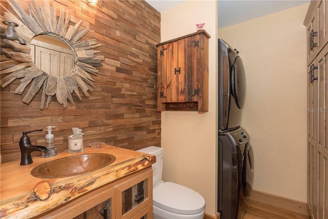 1/2 Bath complimented with custom Beatle Kill vanity top - Single Family Home for sale at 1199 Seahorse Ln, Englewood, FL 34224 - MLS Number is D6110877