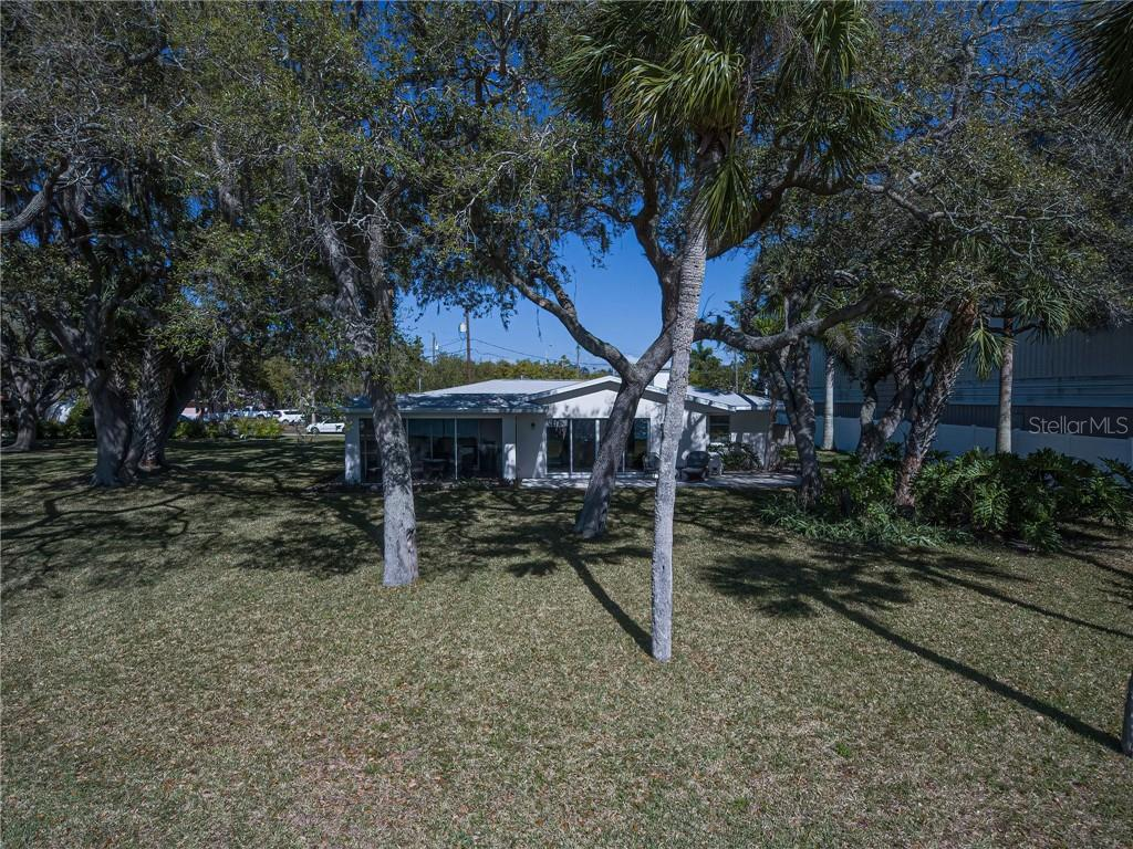 Enjoy the dappled light and shade until it fades to sunset. - Single Family Home for sale at 918 Edgewater Dr, Englewood, FL 34223 - MLS Number is D6111167