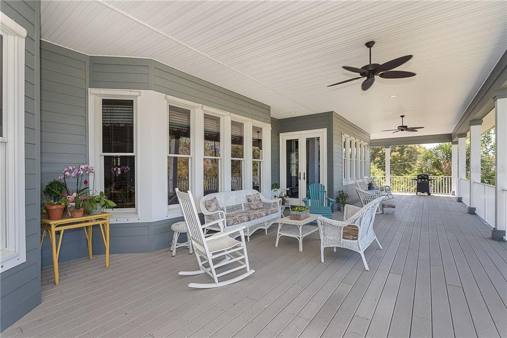 Large rear porch has room to sit and sip your tea on a lazy afternoon or host an informal gathering of friends. - Single Family Home for sale at 550 S Oxford Dr, Englewood, FL 34223 - MLS Number is D6111512