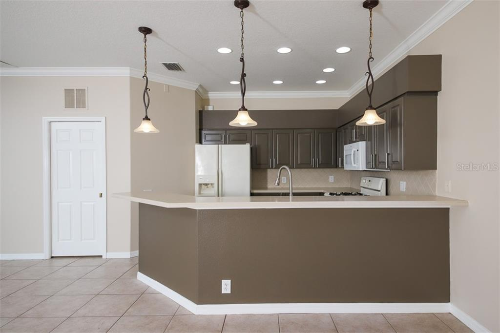 KITCHEN AND BREAKFAST BAR - Single Family Home for sale at 3583 Royal Palm Dr, North Port, FL 34288 - MLS Number is D6111716