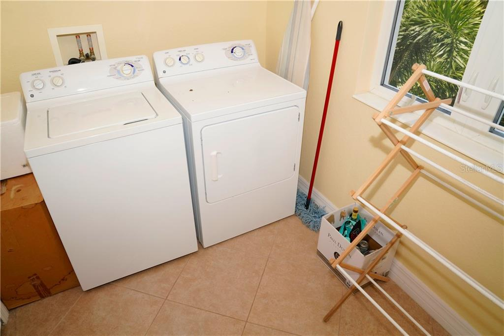 Laundry room off kitchen - Condo for sale at 2245 N Beach Rd #304, Englewood, FL 34223 - MLS Number is D6112346