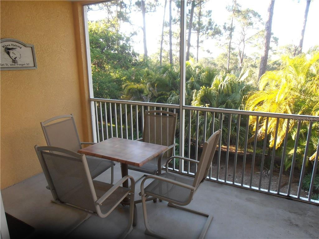 View of environmental preserve from the lanai. - Condo for sale at 8409 Placida Rd #203, Placida, FL 33946 - MLS Number is D6112643