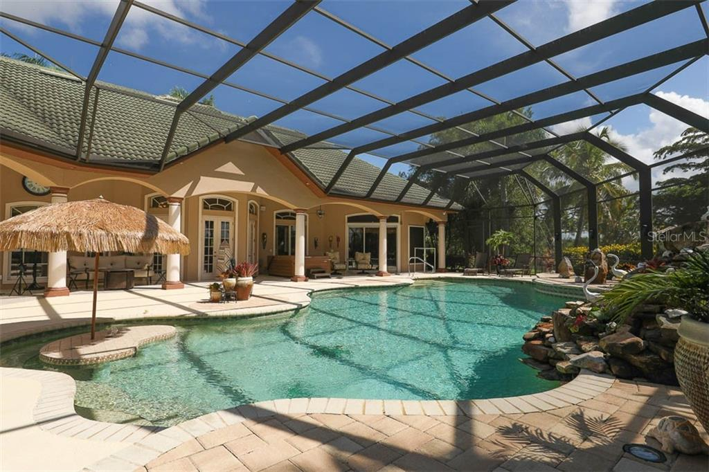 Pool View to Home - Single Family Home for sale at 9300 Hialeah Ter, Port Charlotte, FL 33981 - MLS Number is D6113597
